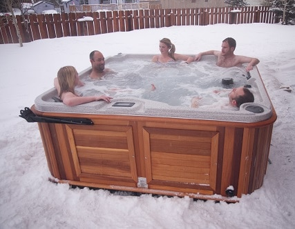 five person in an Arctic Spas hot-tub in winter